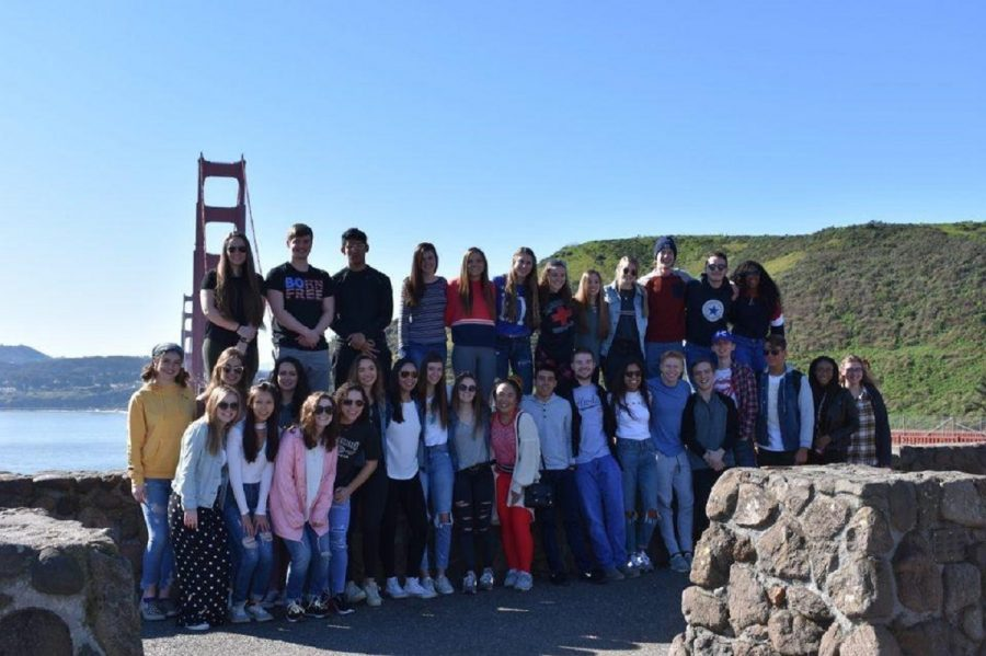 Part of the Class of 2019 taking a picture near the Golden Gate Bridge.