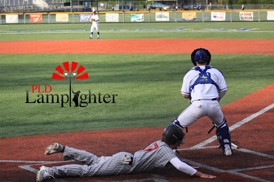 #27 Jared Gadd diving to home plate.