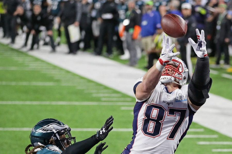 Former Patriots tight end Rob Gronkowski going up to catch the ball over an Eagles defender.