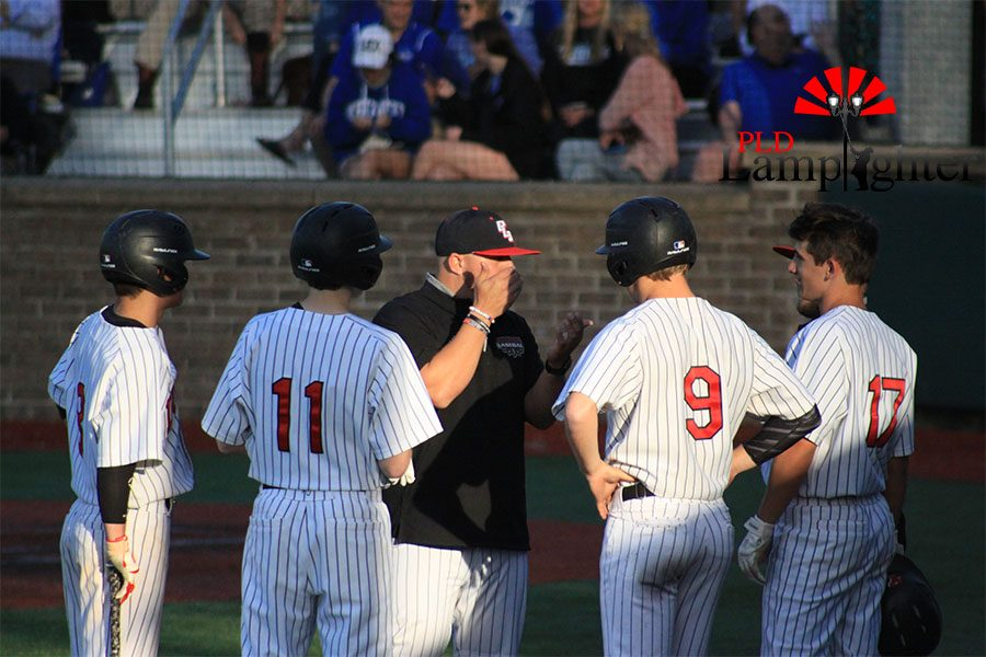 #17 Jake Smith, #9 Gunnar Wheatley, and #11 Will Hord talking with Coach Deaton.
