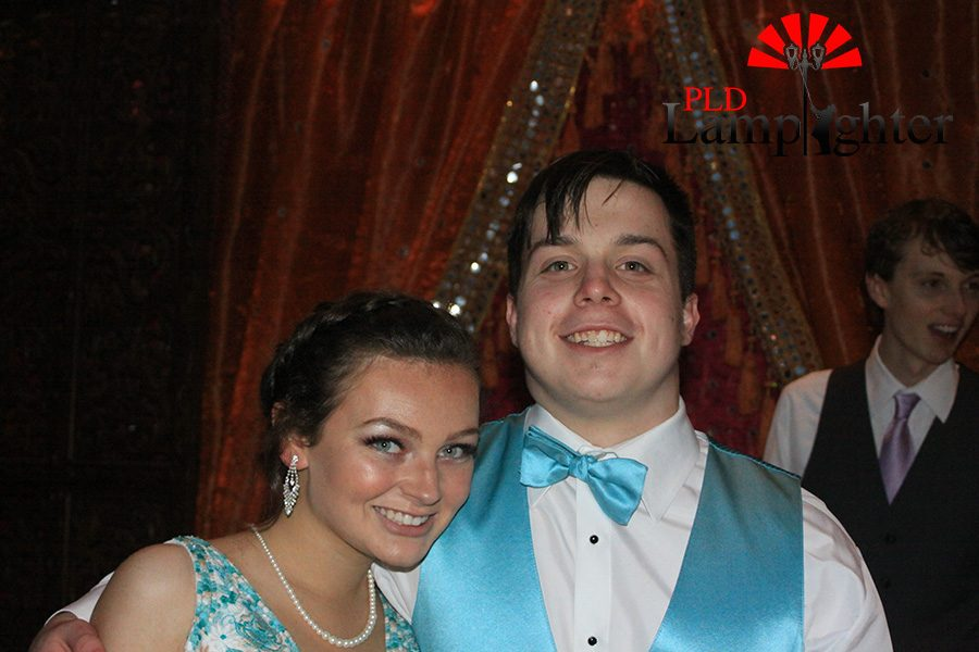 A couple shows off their matching blue prom gear.