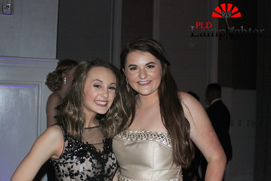 Olivia Doyle and Kristin Bruins take a quick picture before returning to the dance.
