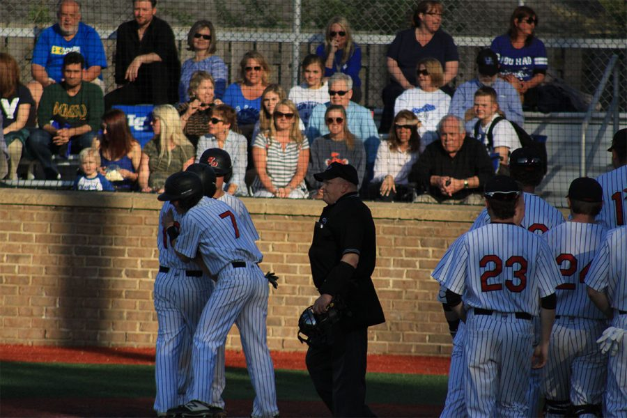 #7 Matt Hall congratulating #18 Cameron Baughman after he hit a homerun.