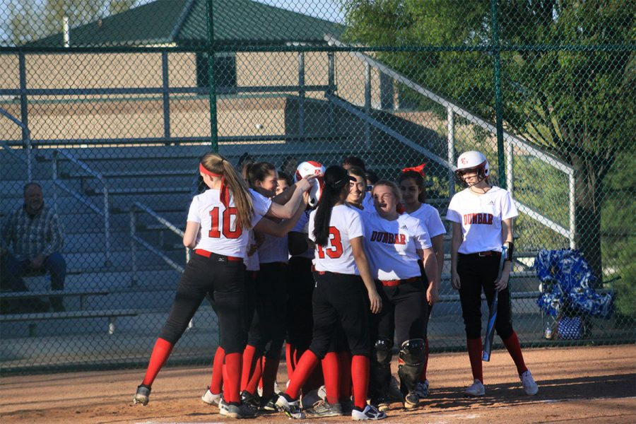 Teammates celebrating with #6 Bailey Conley after she hit a homerun.
