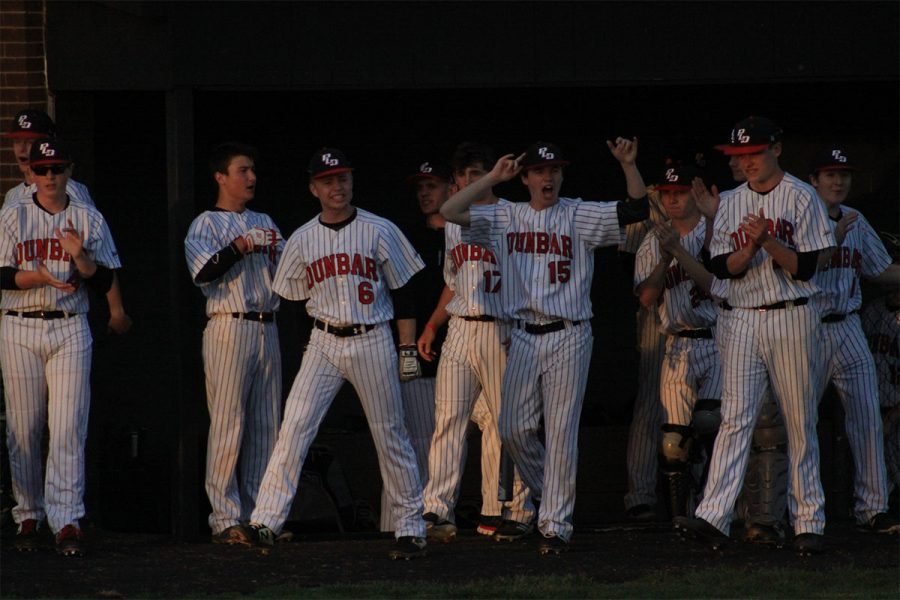 The Dunbar dugout coming out to celebrate a good hit.