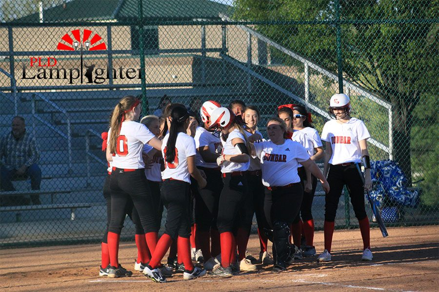 The+Bulldogs+rallying+at+home+plate+after+%236+Bailey+Conley+hit+a+home+run