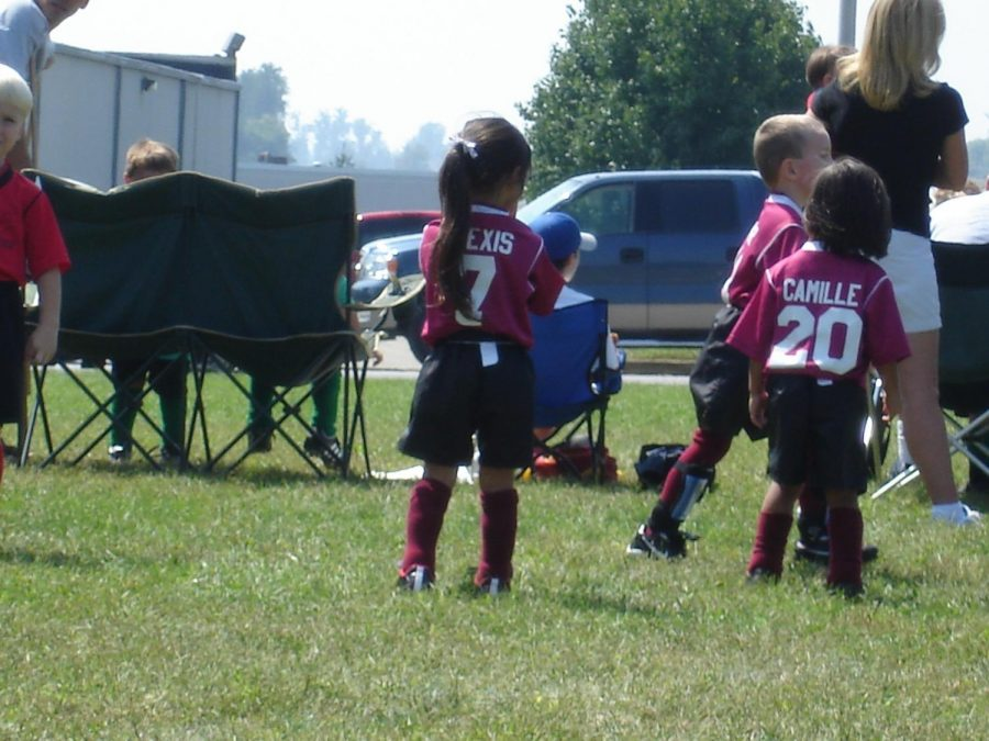 Alexis and Camille playing soccer together.