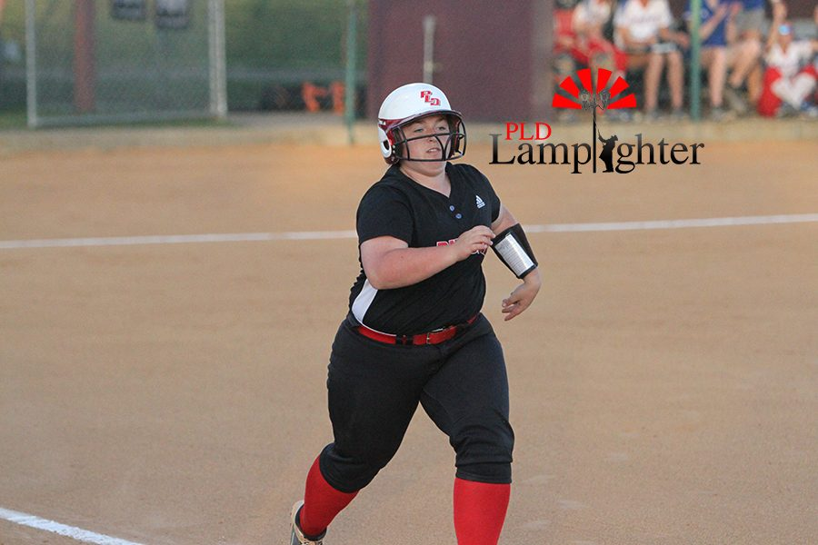 #11 Olivia Judy after a long hit to outfield.
