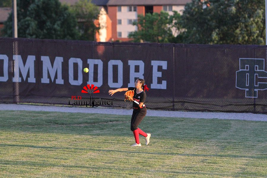 # 23 Jasmin Delira making plays for her team outfield.
