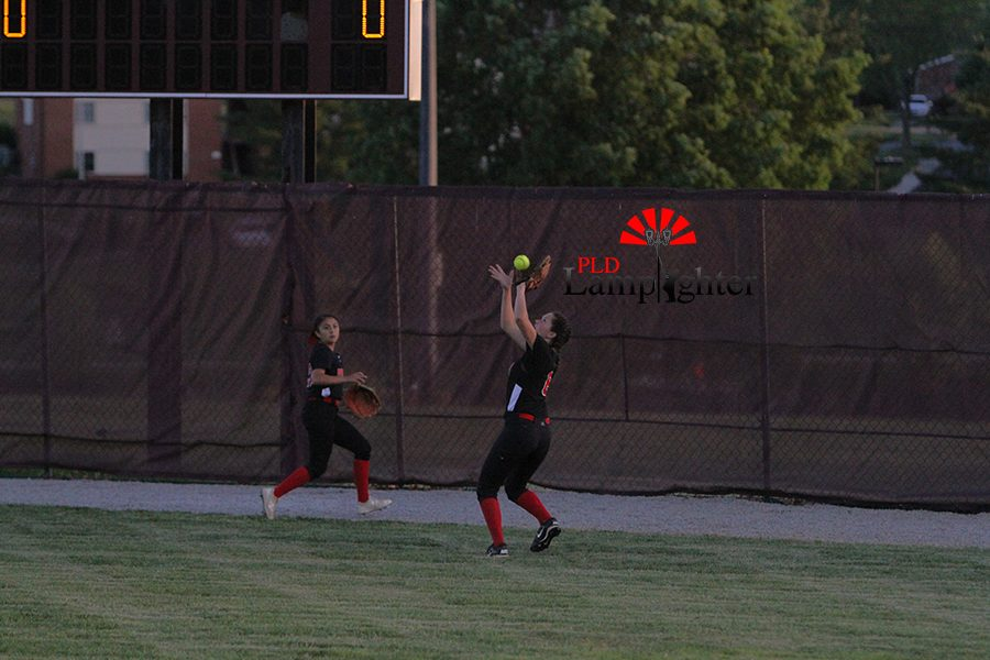 #8 Isabella Schweighardt catching a pop fly outfield.