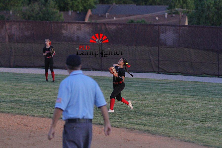 #23 Jasmin Delira throwing the ball back infield.