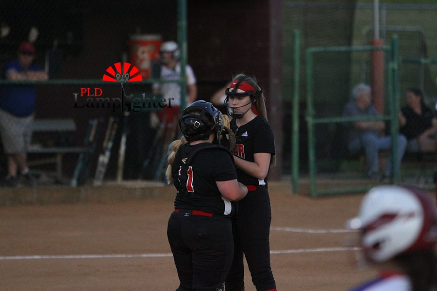 #11 Olivia Judy regroups with #10 Melisa Nelson after a tough 1st inning for defense.