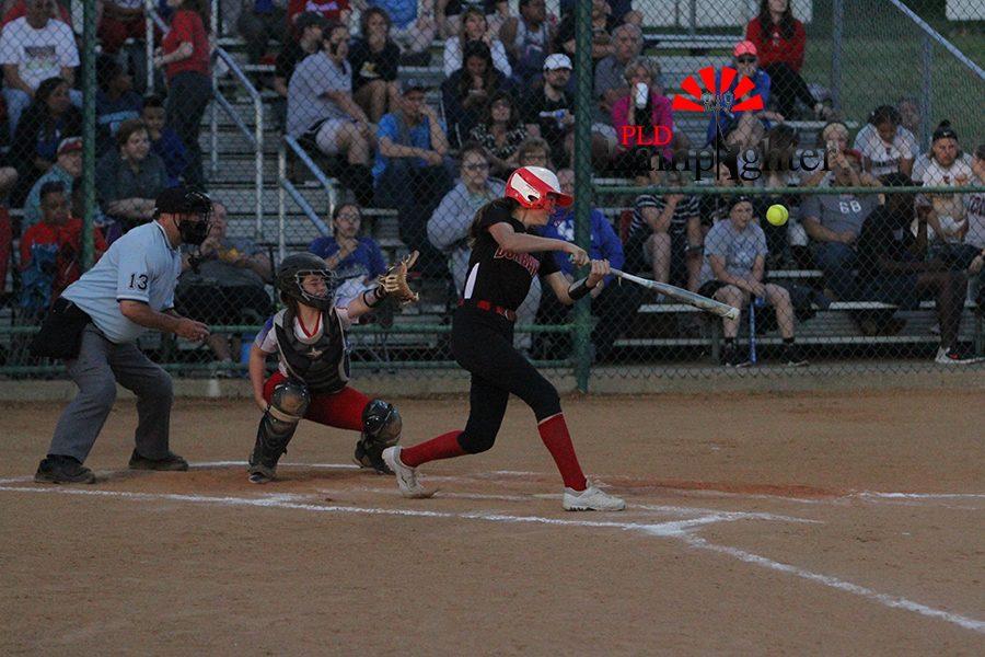 #2 Kate Schweighardt hits fly ball towards left field.