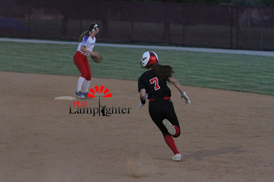 #7 Brooke Rhyne hits a deep line drive to the outfield fence resulting in a double.