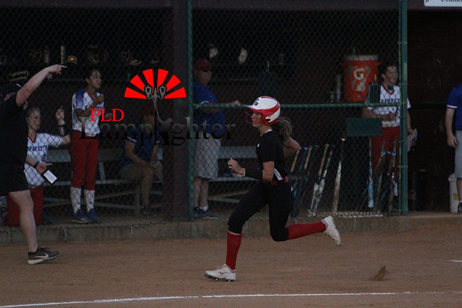#2 Kate Schweighardt rounds third and heads home following a deep line drive.