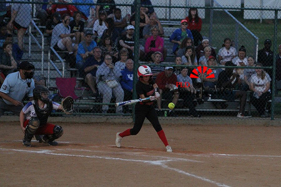 #23 Jasmin Delira swings at a low strike for a base hit.