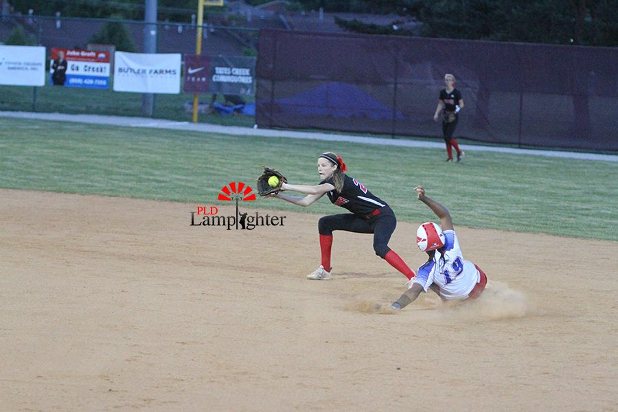 #11 Olivia Judy picks off runner trying to steal on throw to shortstop.