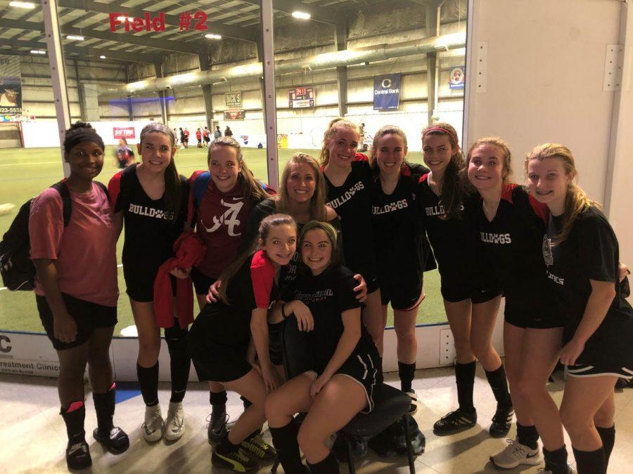 Dunbar's indoor soccer team huddled together for a picture.
