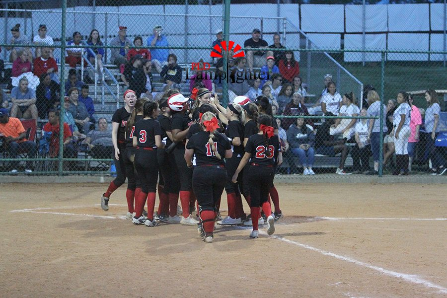 #6 Bailey Conley hits her first of two home runs to right field on an 0-2 count.