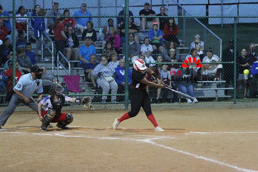 #9 Yanna Marrow hitting a ball coming her way.