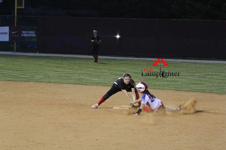 #22 Erica Vain tags out a runner trying to steal.