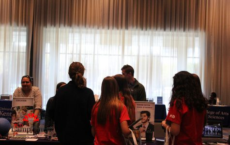 PLD students talk to a college booth about a education career.