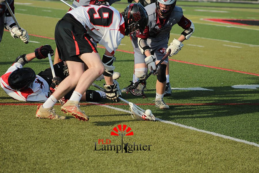 #29 Alex Natale picks up the loose ball.