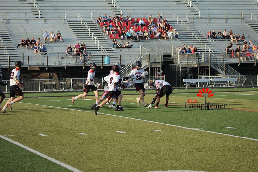 Dunbar players attack a loose ball.