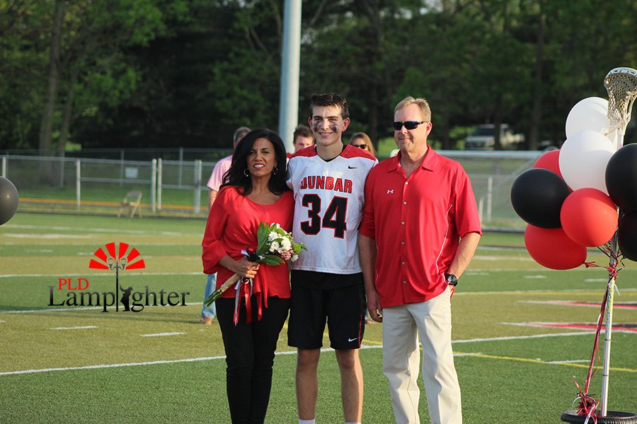 Drew Herald with his parents for senior night.