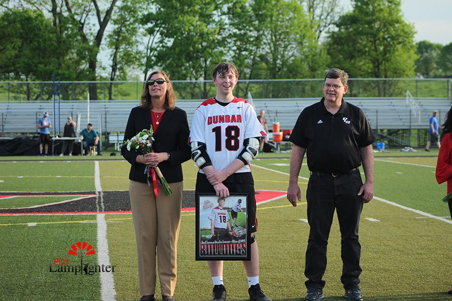 John Albright with his last game as a Dunbar Lacrosse player.