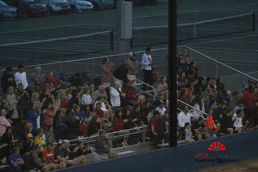 PLD fans standup to applaud their players.