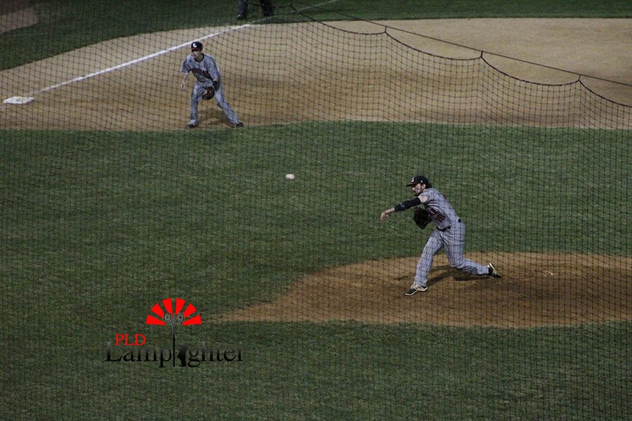 #18 Cam Baughman, pitches a fastball to the batter.