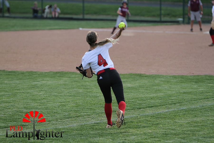 %234+Kennedy+Messer+throws+the+ball+to+first+base+to+keep+a+runner+from+going+to+second+base.