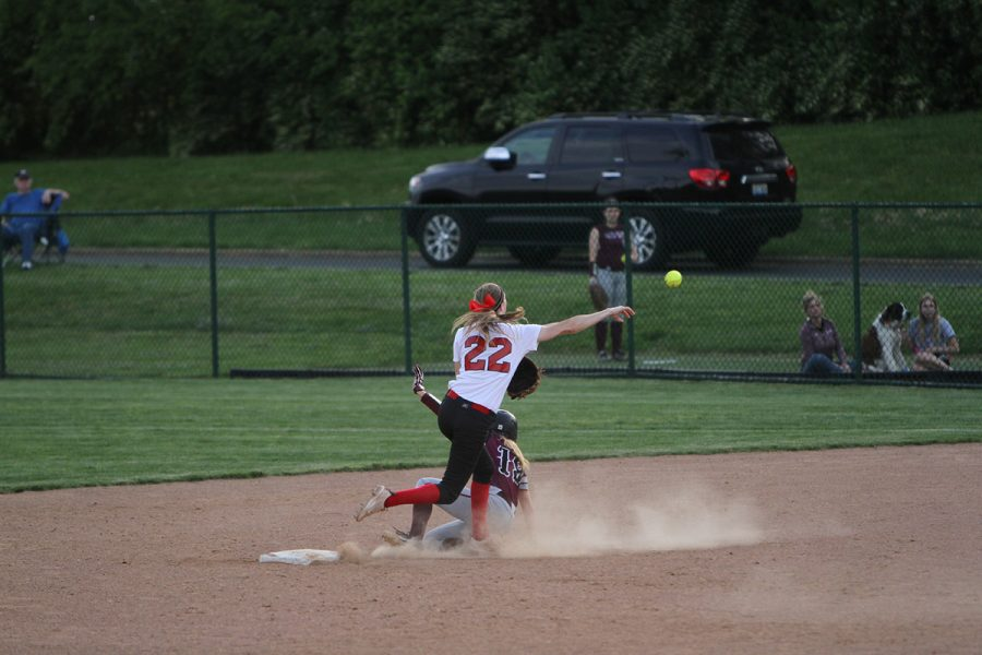 #22 Erica Vain throws the ball to first base, after stepping on second to try and create a double play.