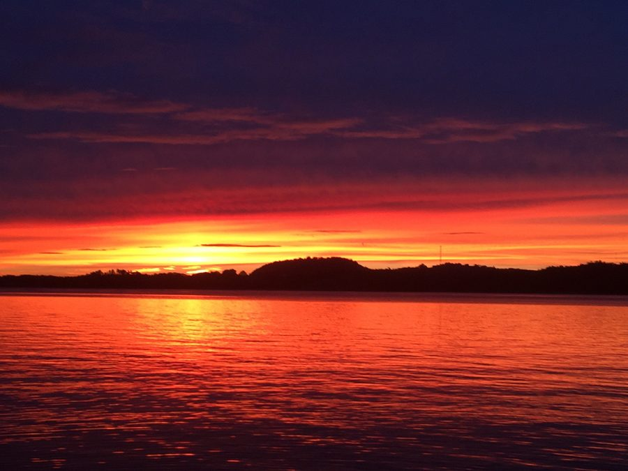 This is a picture of a sunset taken on top of my uncles dock at his lake house.