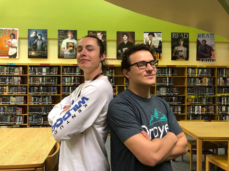 Chris Williams and Mason Curtis pictured in the Dunbar Library.