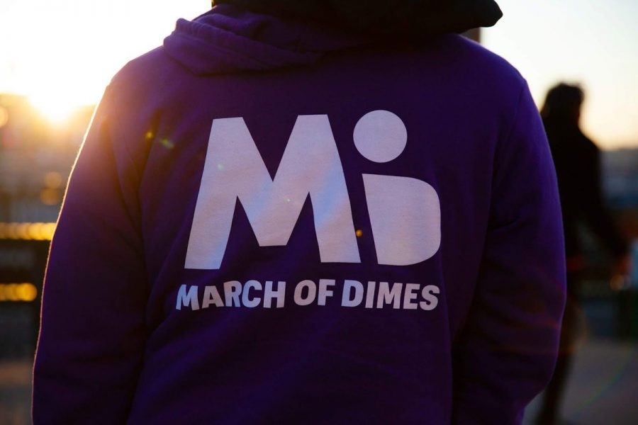 The March of Dimes logo on the back of a sweatshirt.