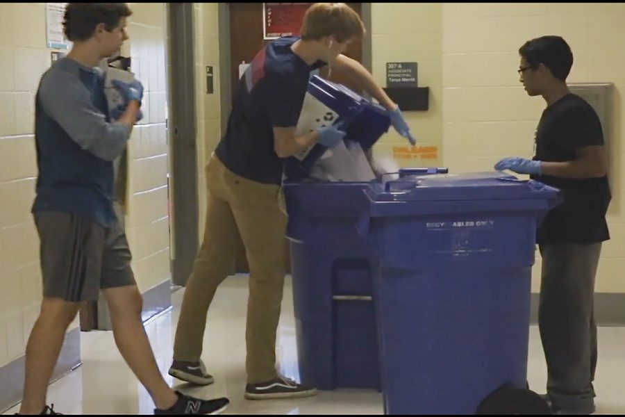 The recycling club going around and emptying bins after school.