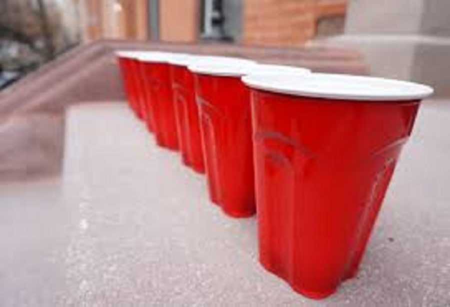 Solo cups sitting on the ground .
