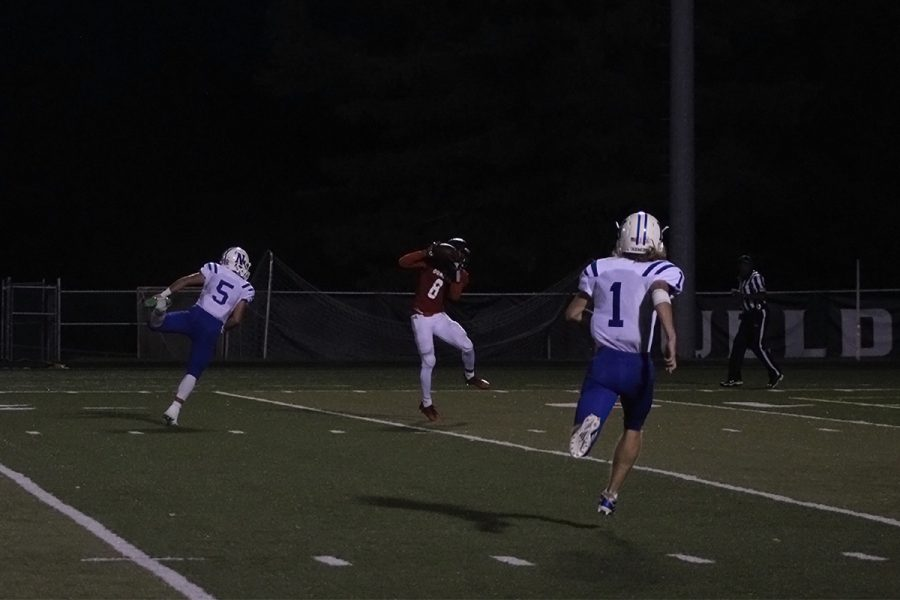 #8 Frank Illunga, receives a pass to go on to score a touchdown for the Bulldogs