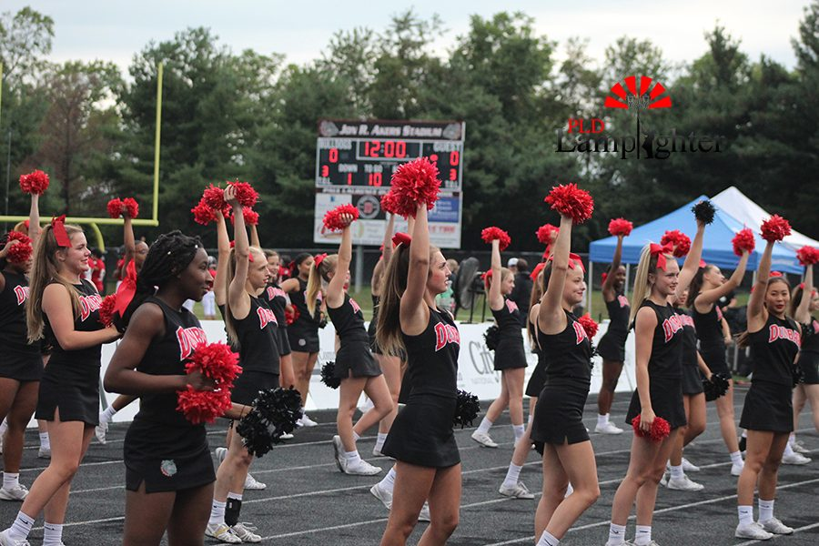 The cheerleaders get the student section excited for a big game.