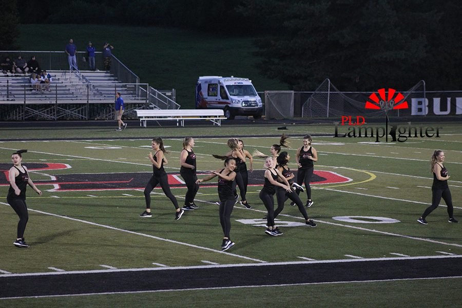 The dance team performs their dance for the halftime show.