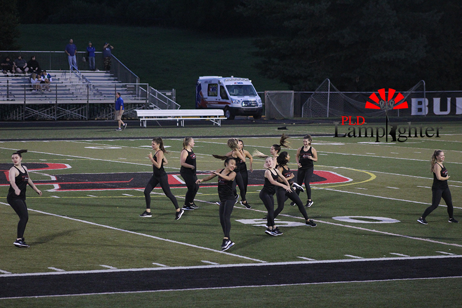The+dance+team+performs+their+dance+for+the+halftime+show.