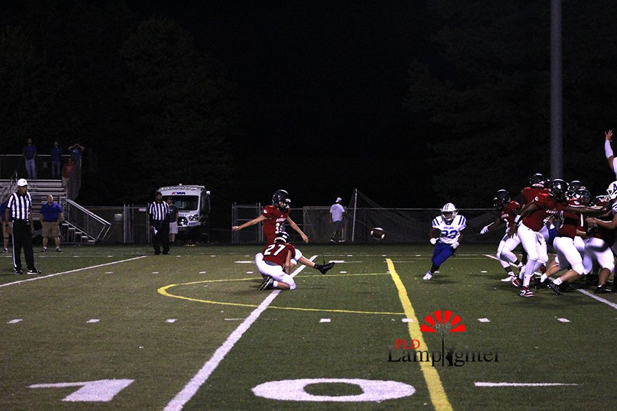 #30 Parker Hadley, kicks the ball to score a Field goal for the Bulldogs.