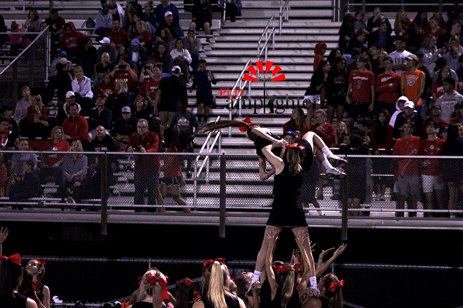 The+cheerleading+team+perform+their+routine+for+the+student+section+during+a+timeout.