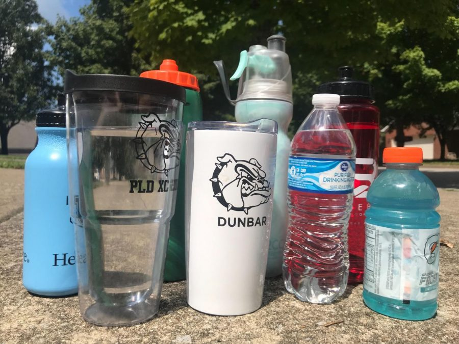 Drinking plenty of fluids, especially water, is key when the temperature rises.