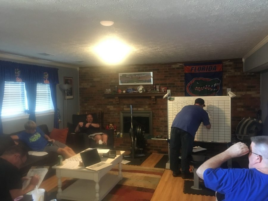 Colton Dalton, Jason Marshall, Jason Garry, and Greg Heirferd at the the Gator Jay Fantasy Football draft. Doug is putting his pick on the board.