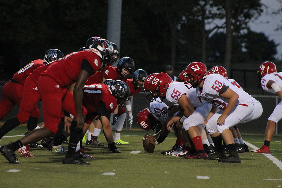 The Dunbar Bulldogs and the West Jessamine Colts faced off for the first down.