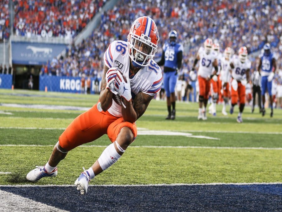 Florida football player runs the ball 75 yards for a touchdown.