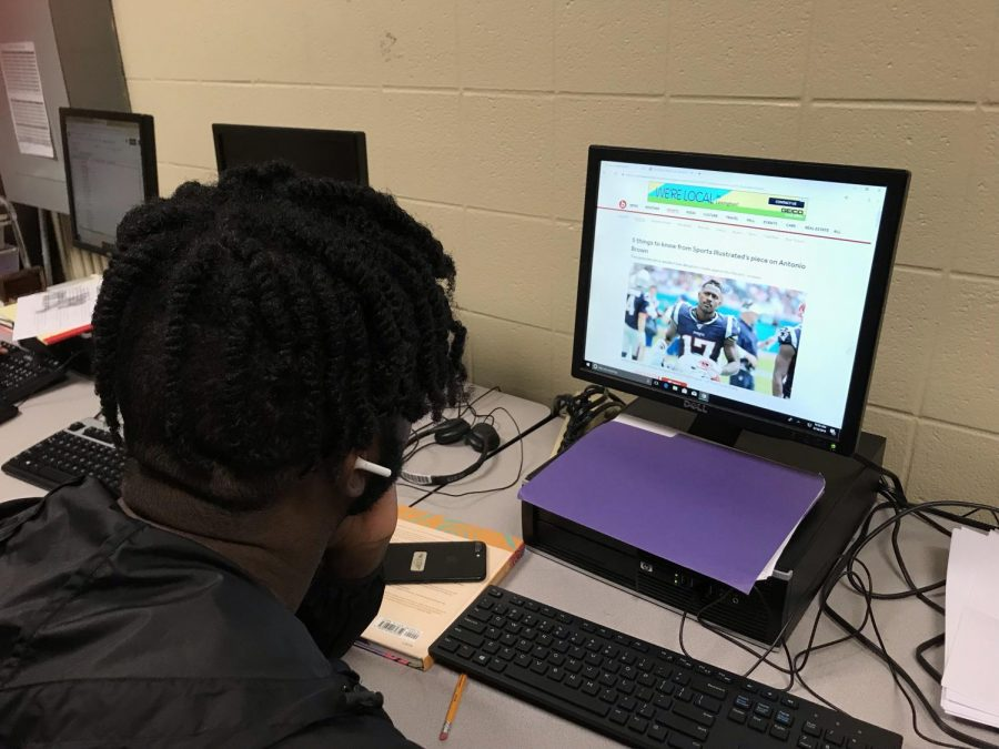 Student reading an online sports article.